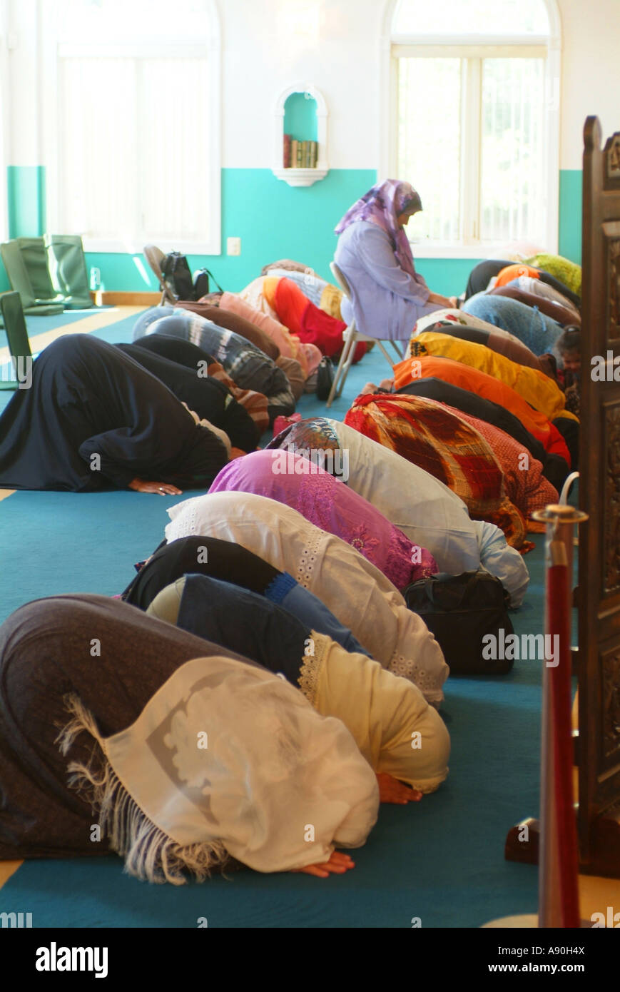 Women pray in the back of the mosque away from the men Stock Photo