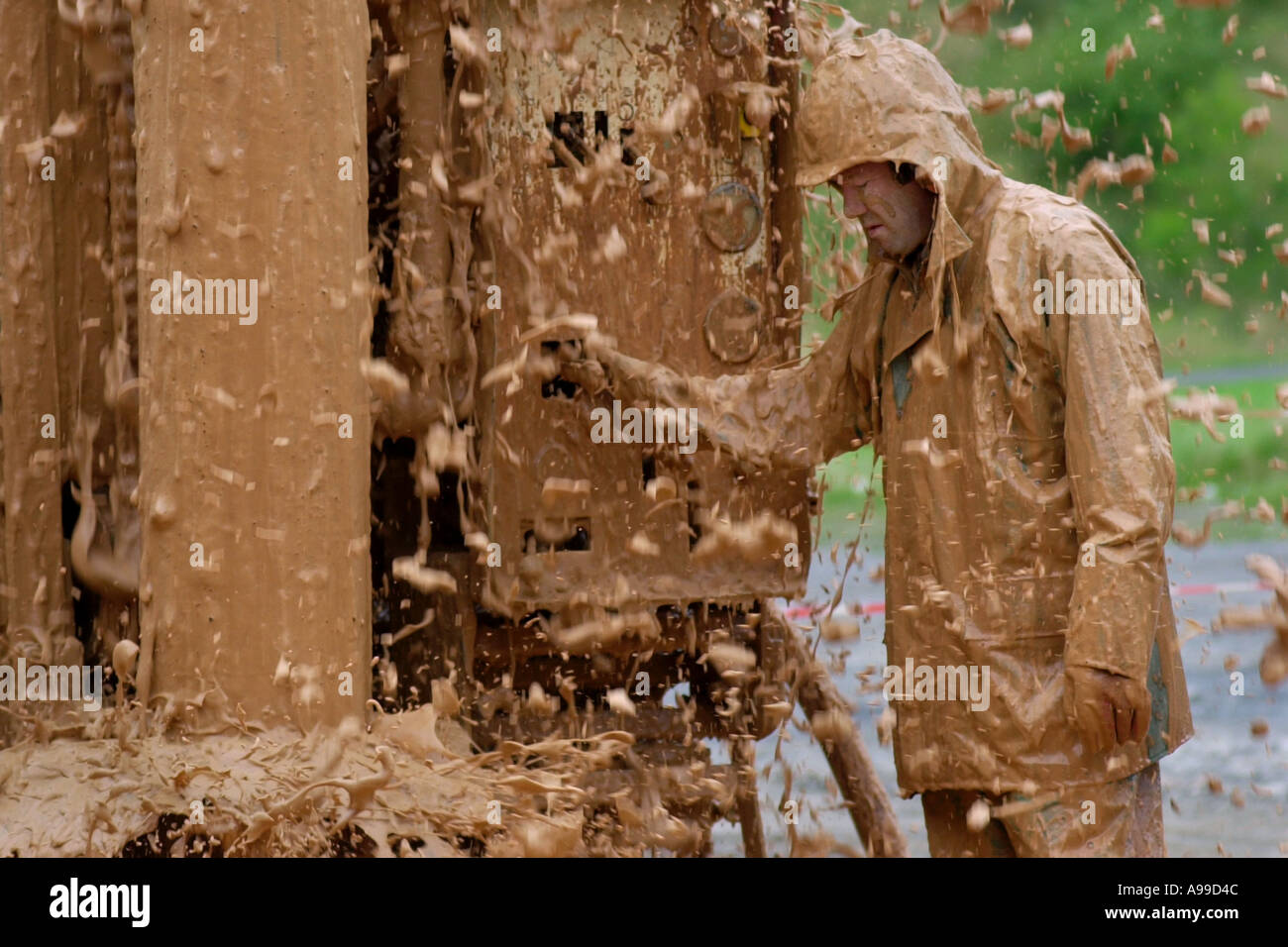 engineer-covered-in-foam-and-mud-while-drilling-for-water-at-the-gwalia-A99D4C.jpg