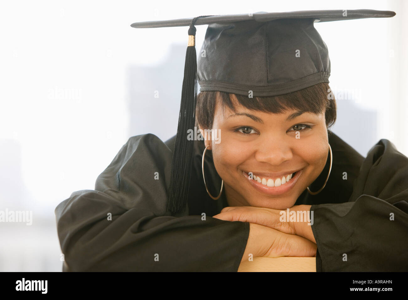 African woman wearing graduation cap and gown Stock Photo: 12425264 ...