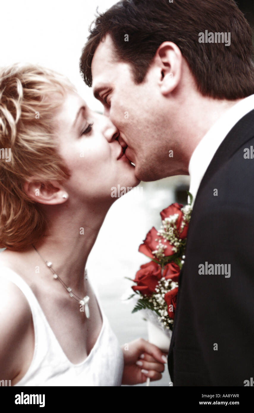 Couple just married kisses MR white Stock Photo