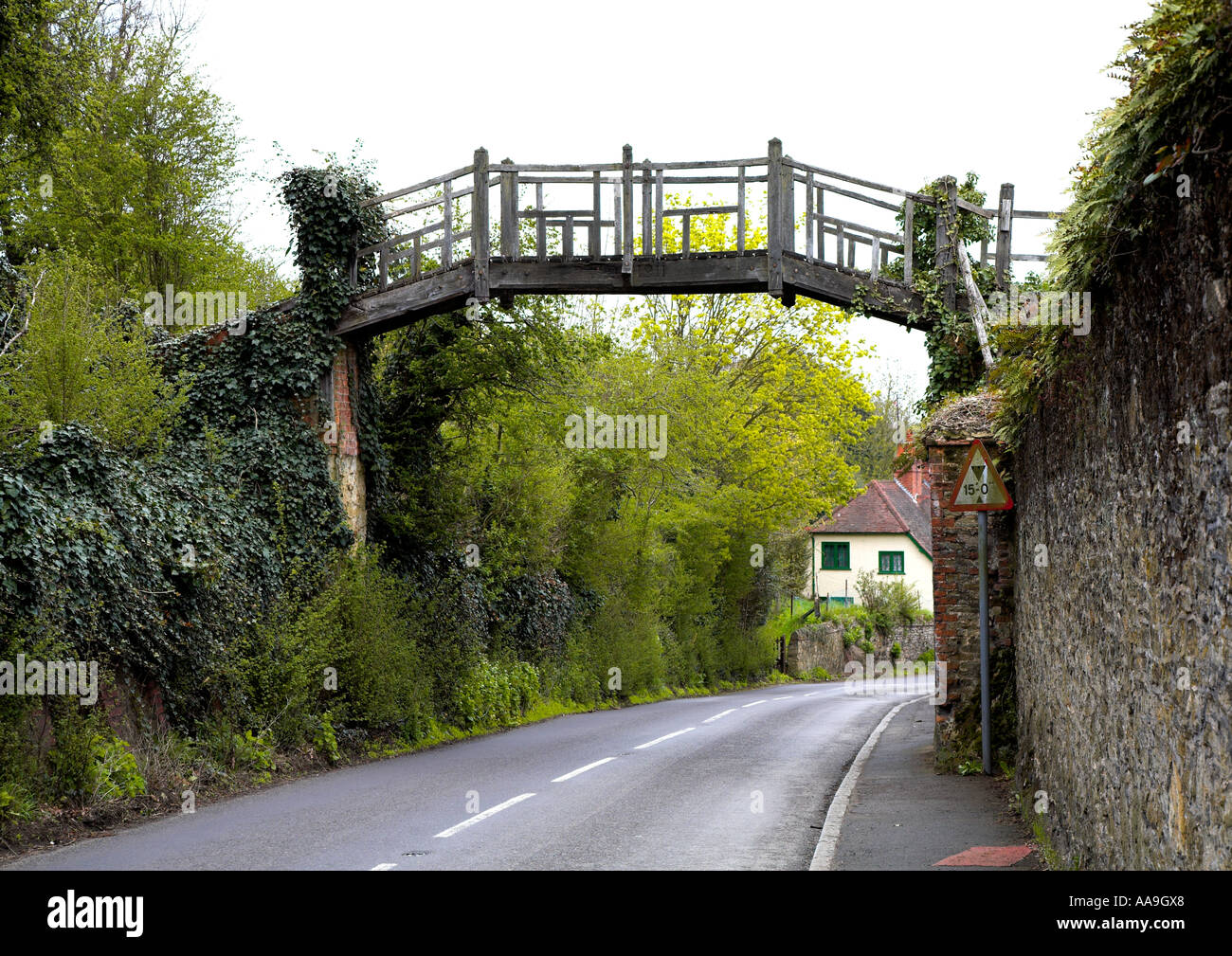 Old wooden bridge over the road in Shere Surrey Stock Photo