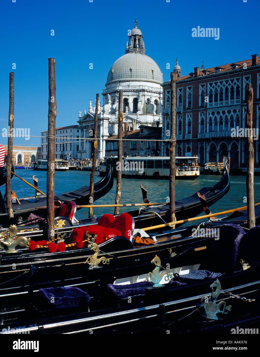 mooring  gondolas opposite Santa Maria della Salute Canal Grande Venice, UNESCO World Heritage Site,  Italy, Europe. - Stock Image