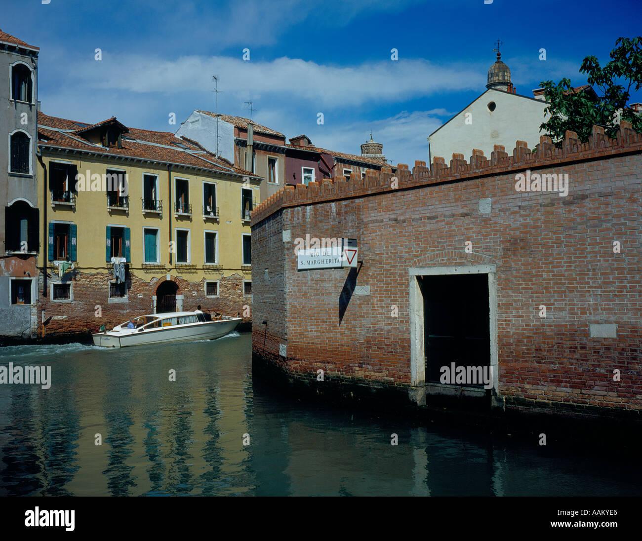 motorboat at Rio de Santa Margherita intersection Rio Nuovo, Venice, UNESCO World Heritage Site, Italy, Europe. - Stock Image
