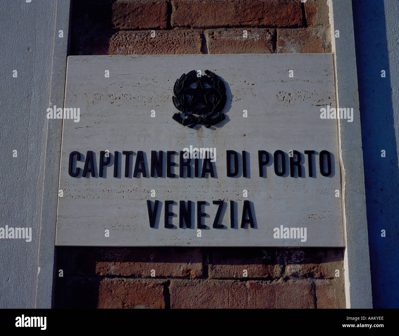 Capitaneria skipper captain office sign building wall port harbour harbor Venice Italy Europe. Photo by Willy Matheisl - Stock Image