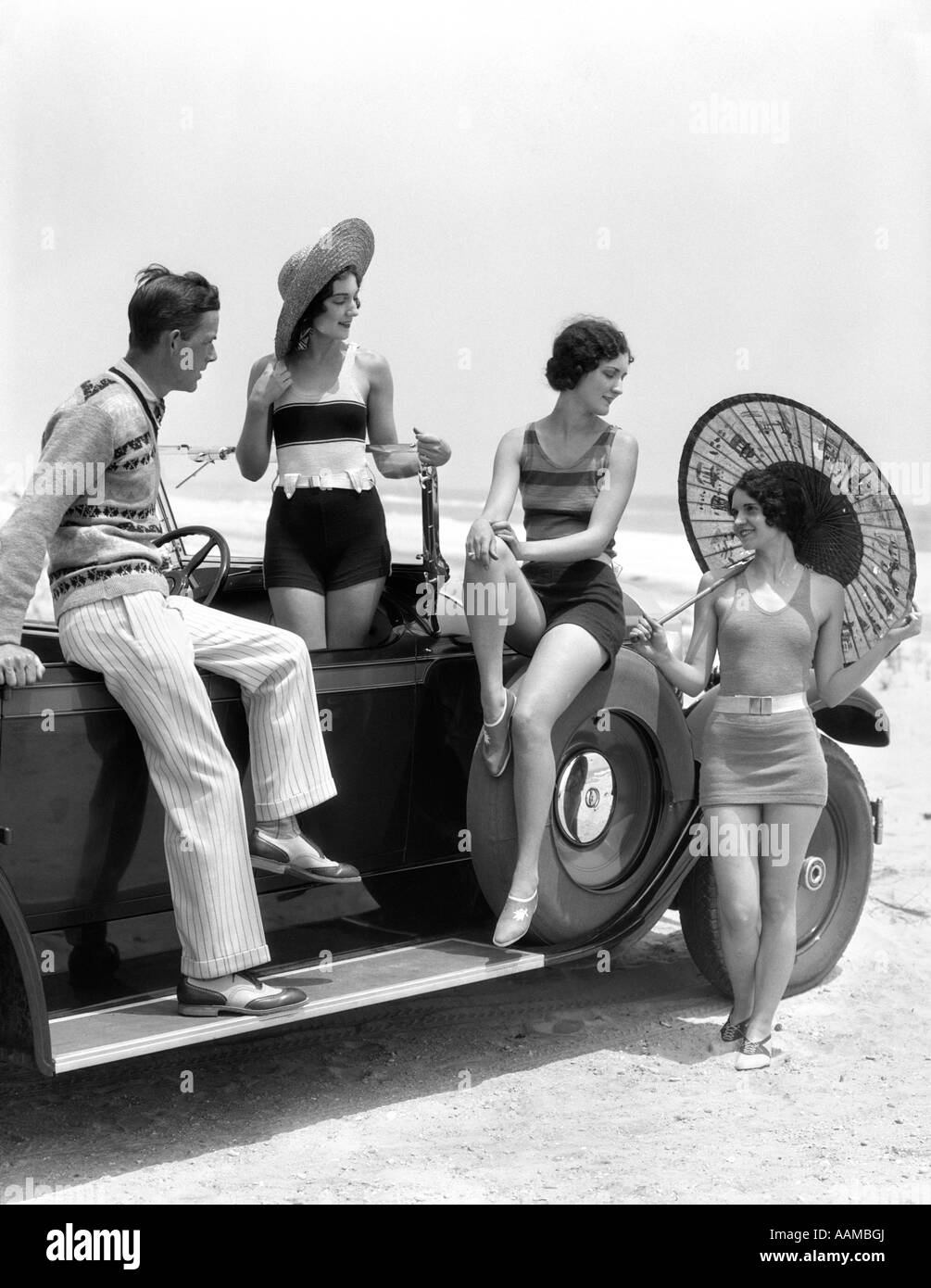 1920s 1930s Man And Three Women In Beach Clothes Or
