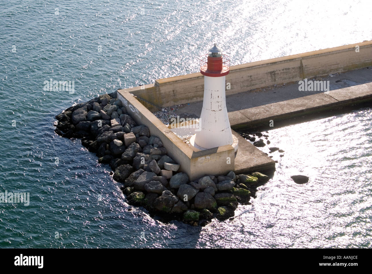 Lighthouse at the entrance to Cagliari Port, Sardinia, - Stock Image