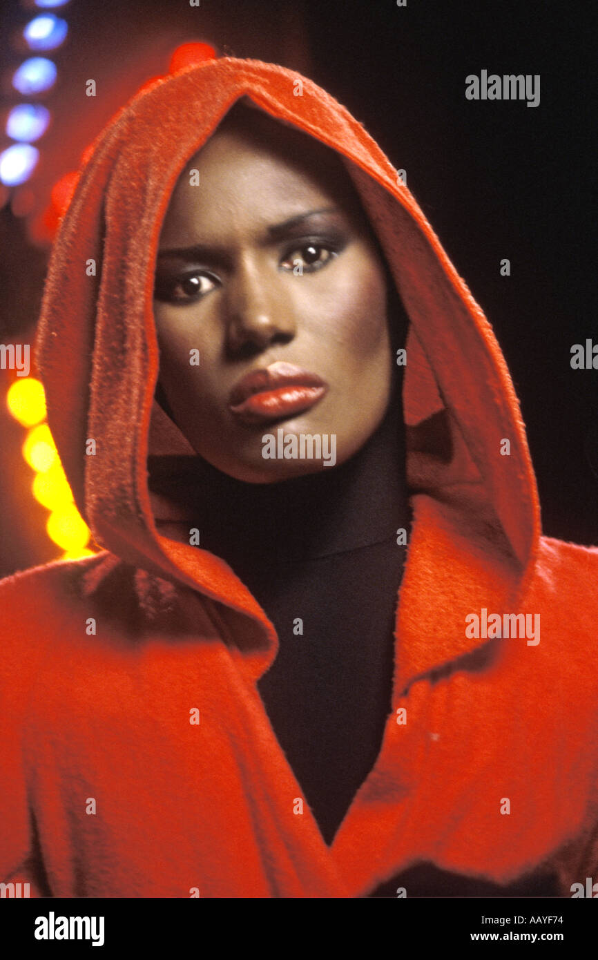 Grace Jones singer full face with red costume and hood PER0036 - Stock Image