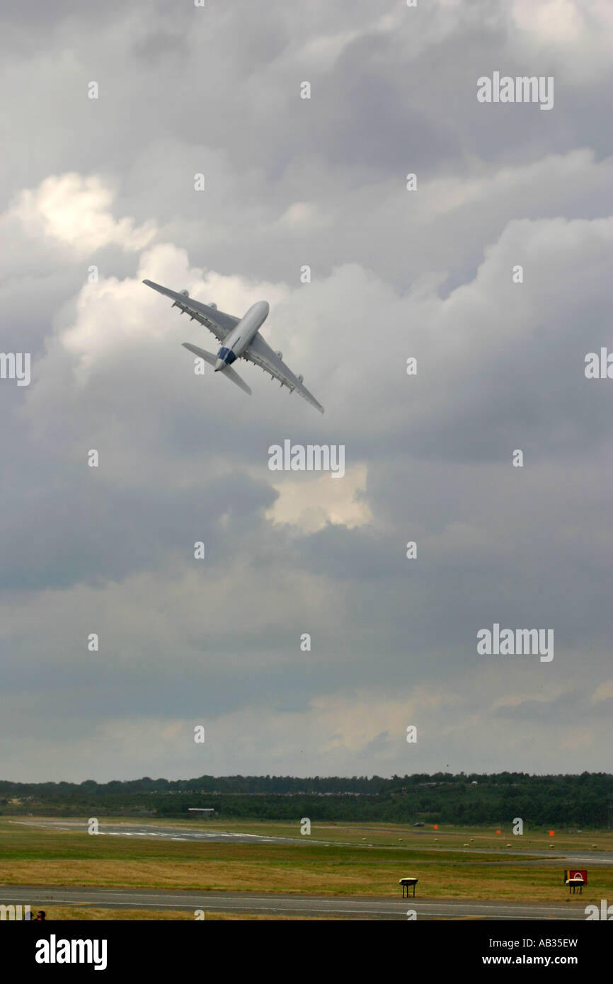 Commercial airliner Airbus A380 performing a steep climb angle along with sharp right turn Farnborough UK - Stock Image
