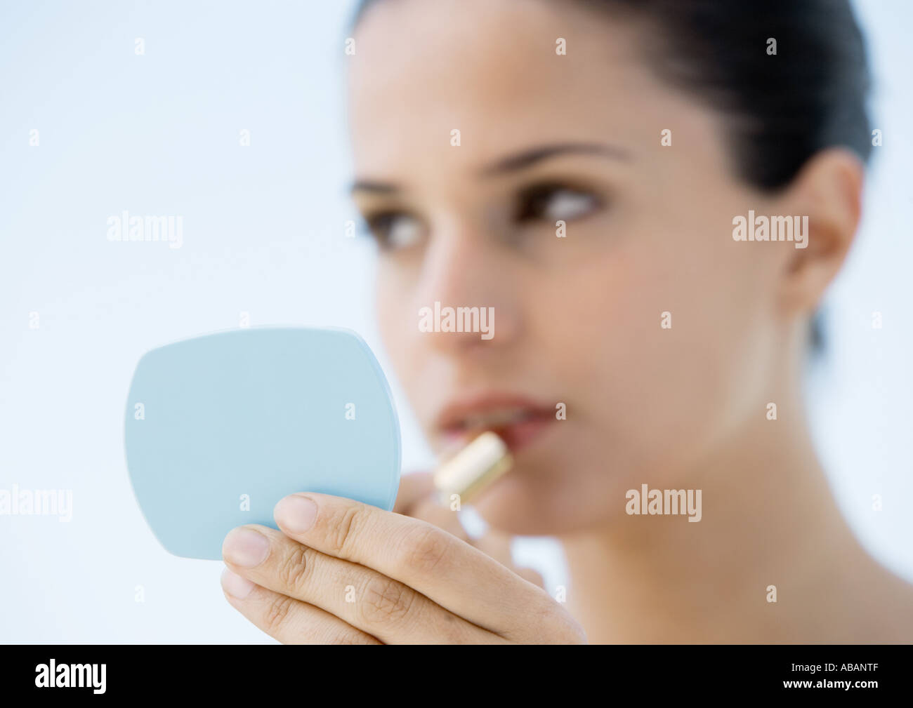 hand holding mirror. Woman Putting On Lipstick, Focus Hand Holding Mirror In Foreground S