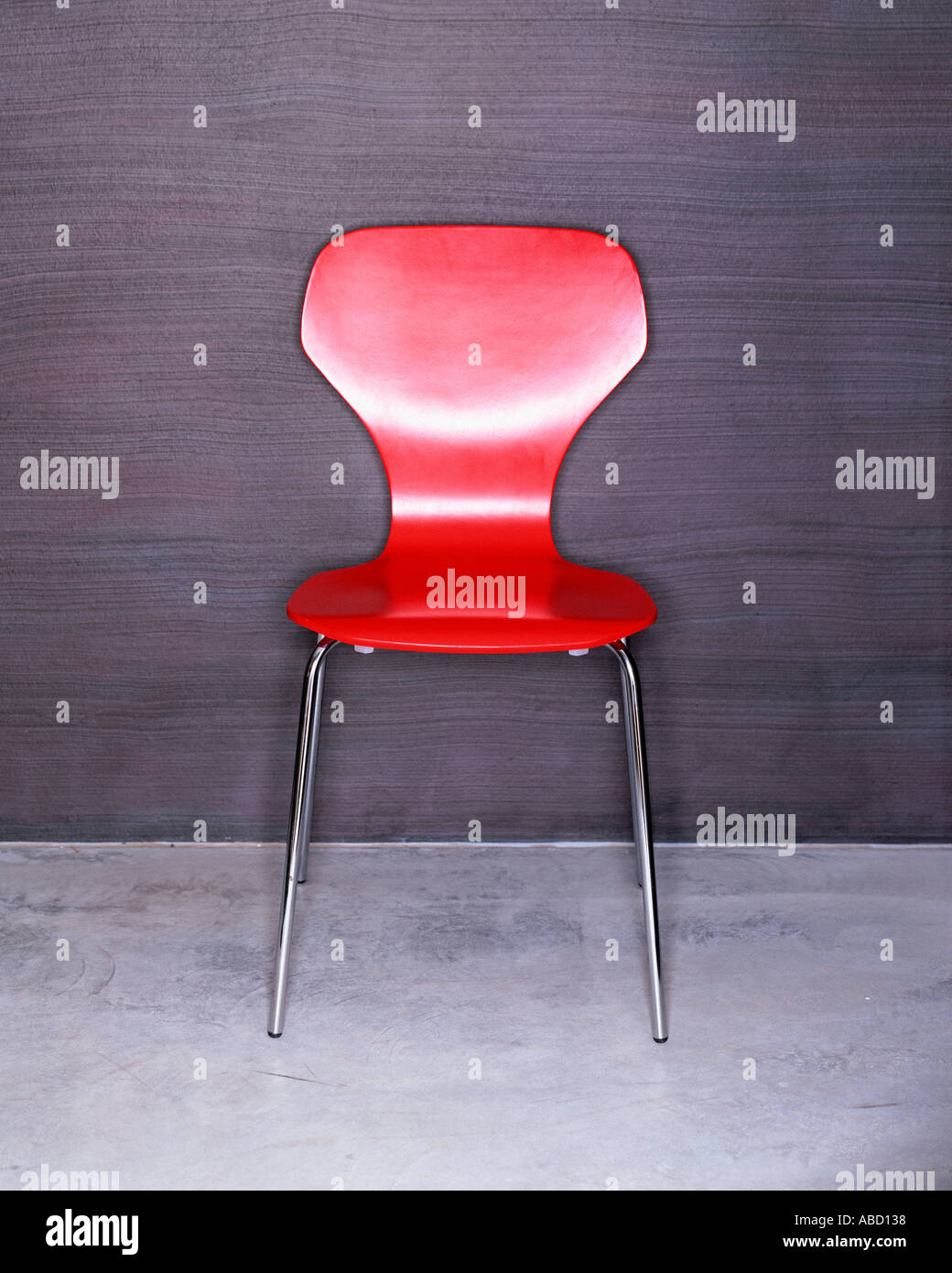 A trendy red chair - Stock Image