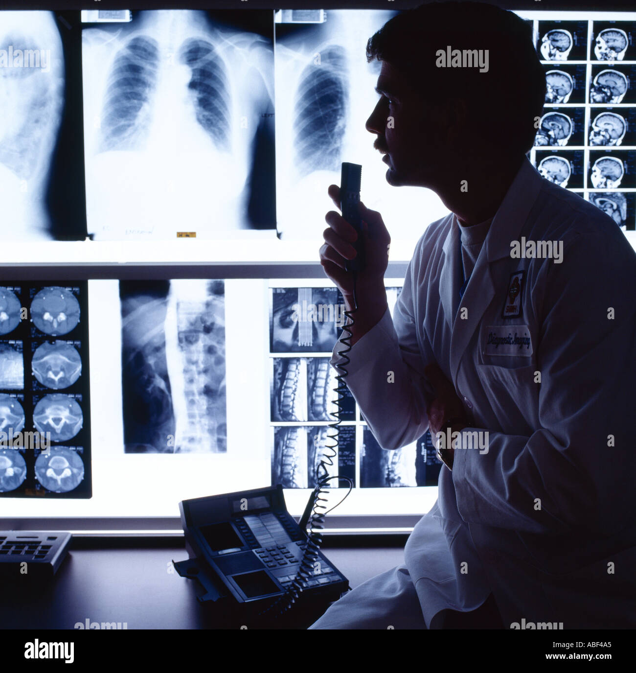 Medical A Doctor Radiologist In A Hospital X Ray Analysis Room