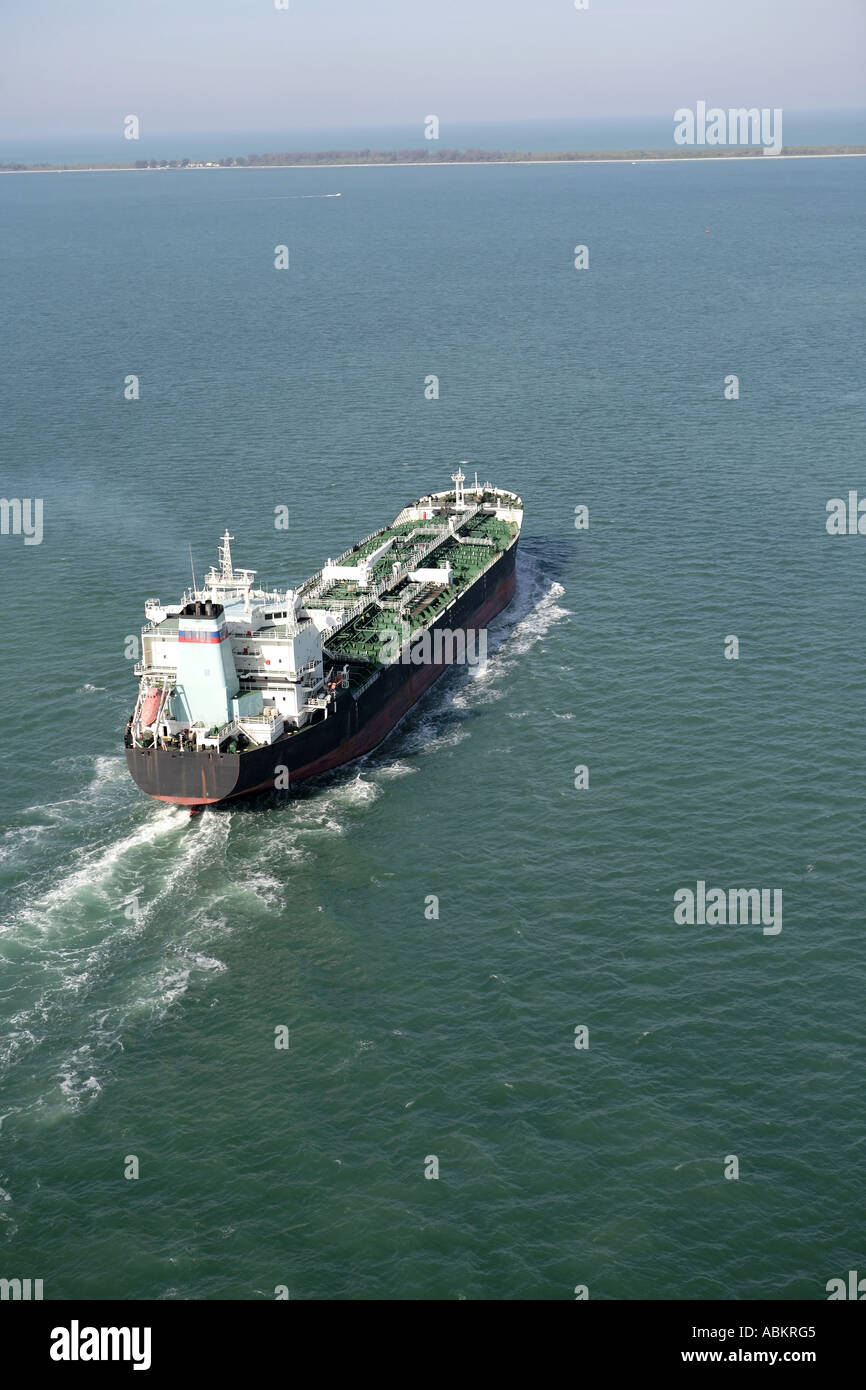 Aerial photo of Cargo Ship in green tropical waters Tampa