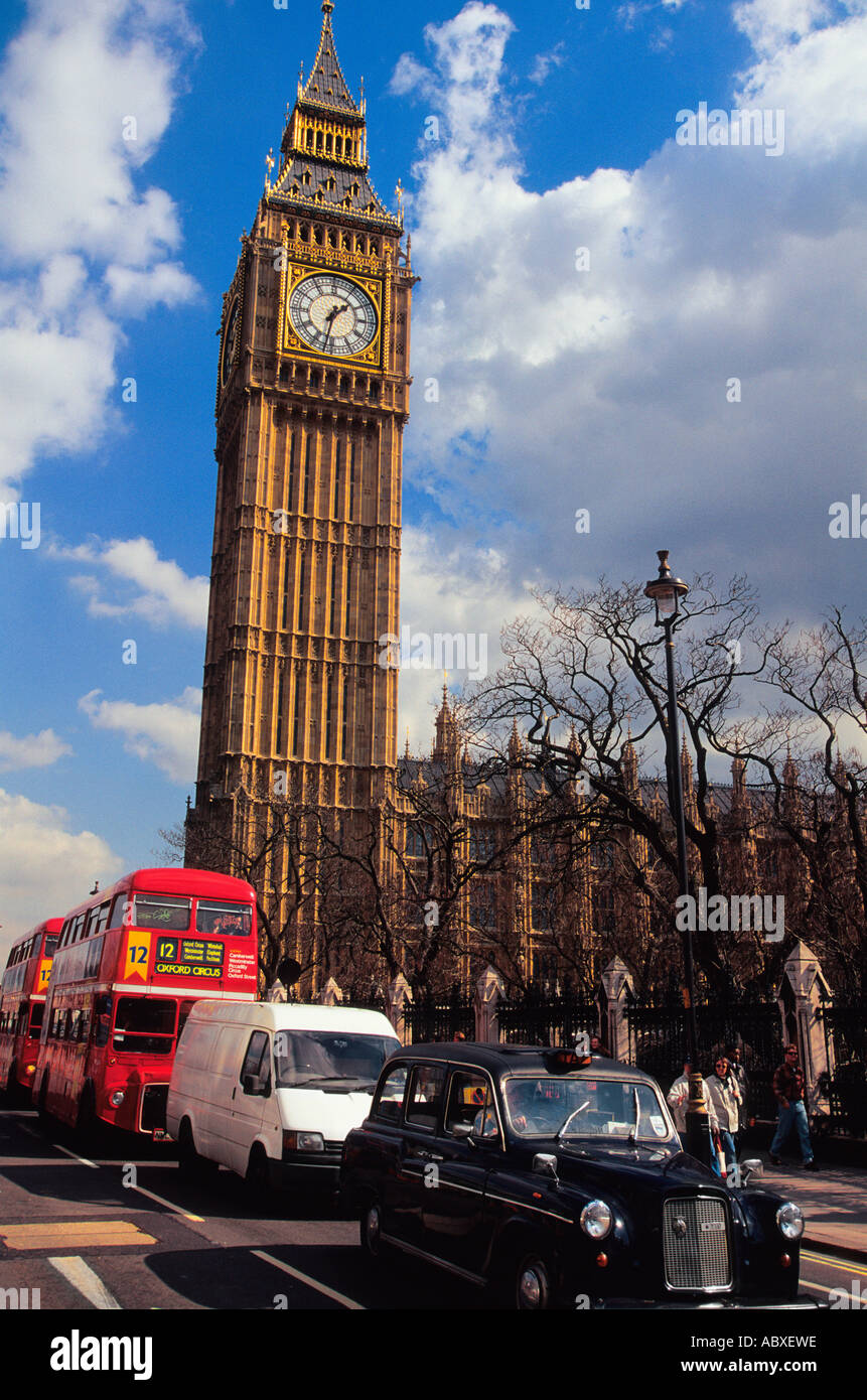 Europe United Kingdom Great Britain UK London England Red Double Decker Bus Traffic and Big Ben - Stock Image
