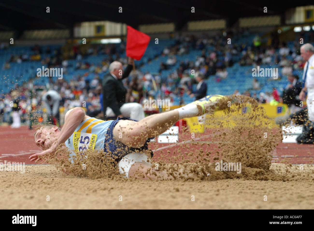 Martin Rossiter crashes to earth in the triple jump Norwich Union World Trials and AAA Championships Stock Photo
