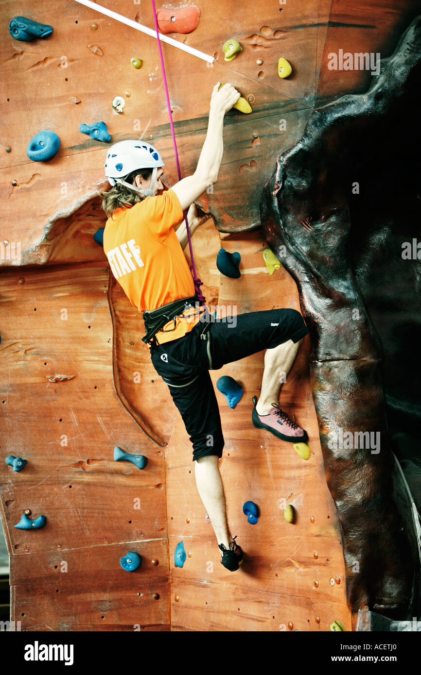 Male climber on indoor climbing wall UK - Stock Image