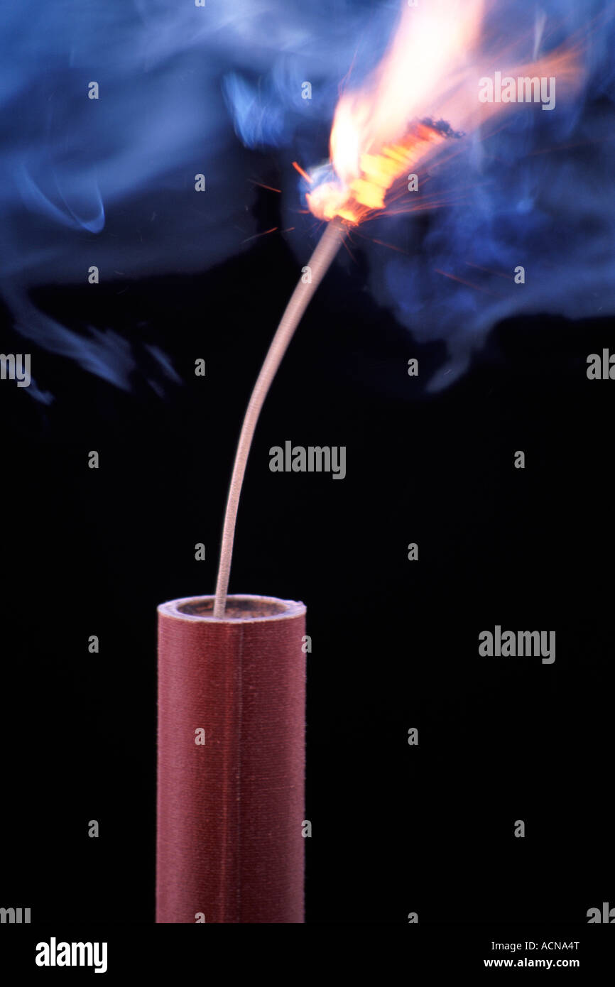 A burning fuse on a stick of dynamite. See also images ACNA1X and ACXTBX. - Stock Image