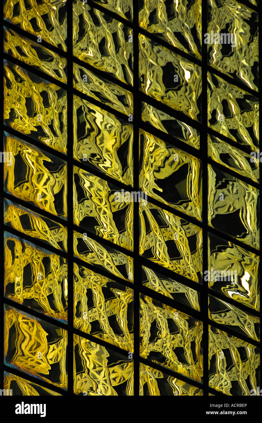 Abstract pattern of reflections in glass clad skyscraper New York USA - Stock Image