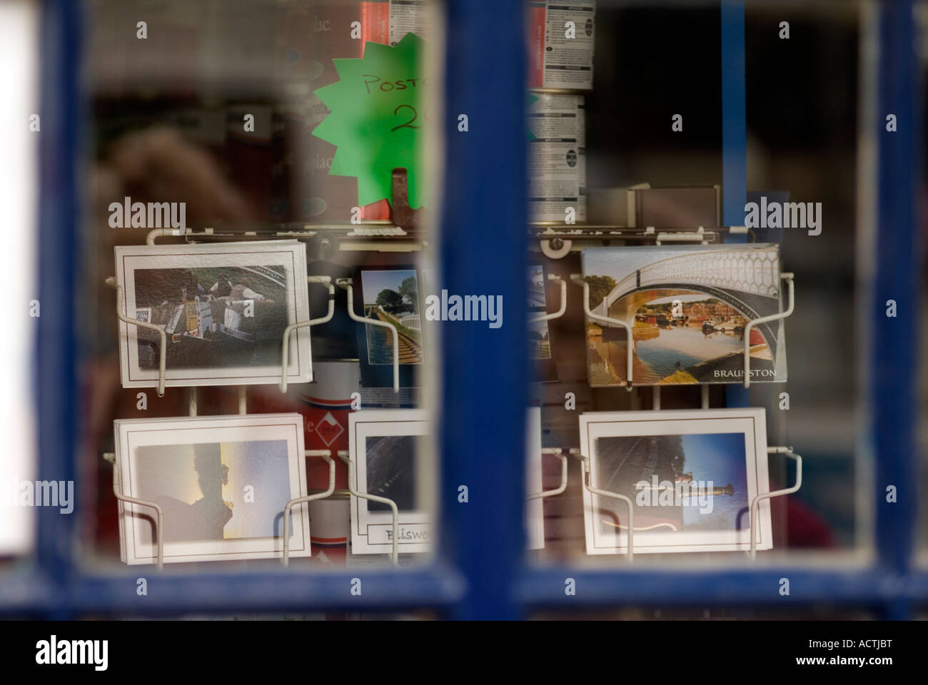 Narrowboat & canal postcards on display in a shop window - Stock Image