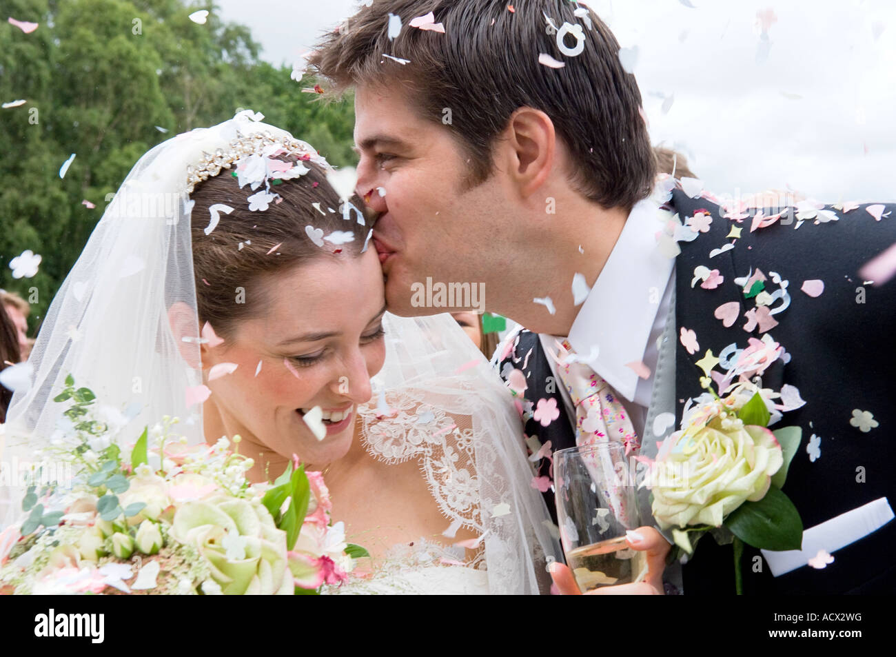 bride and groom with confettiStock Photo