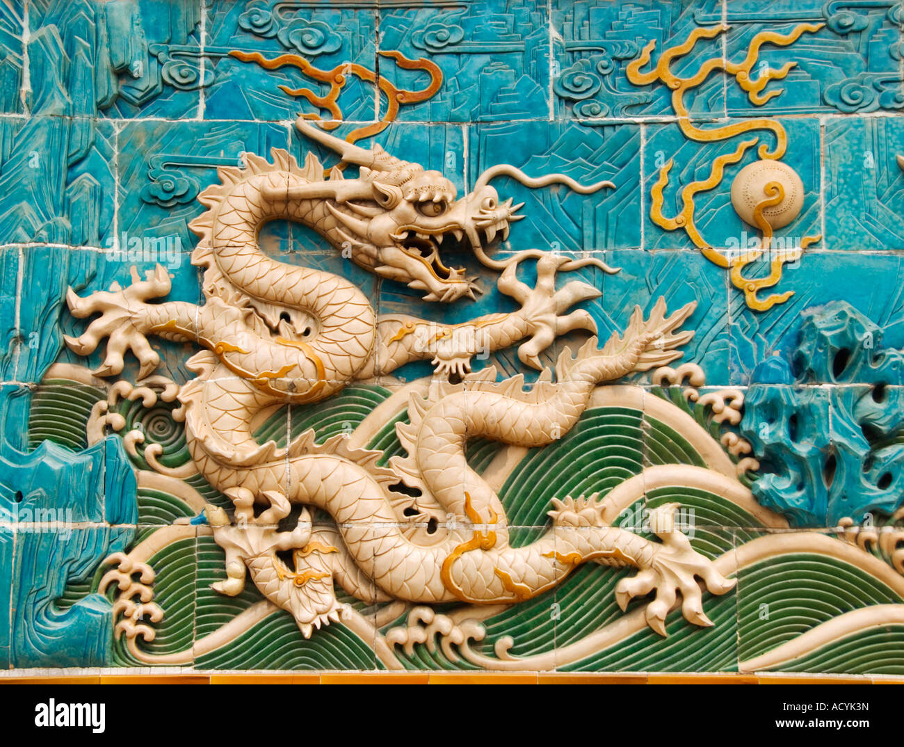 Detail of ornate ceramic dragon on Nine Dragons Screen wall at Beihai Park Beijing 2007 - Stock Image
