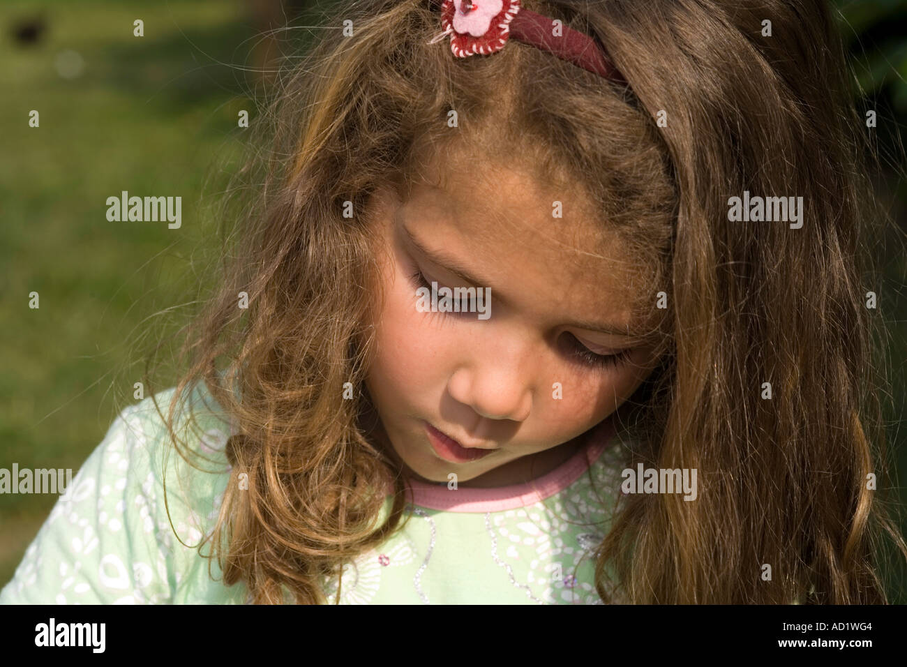 little girl seriously embarassed and depressed - Stock Image