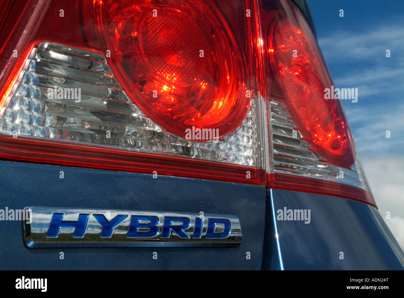 The rear tail light and badge of the Honda Civic Hybrid car - Stock Image