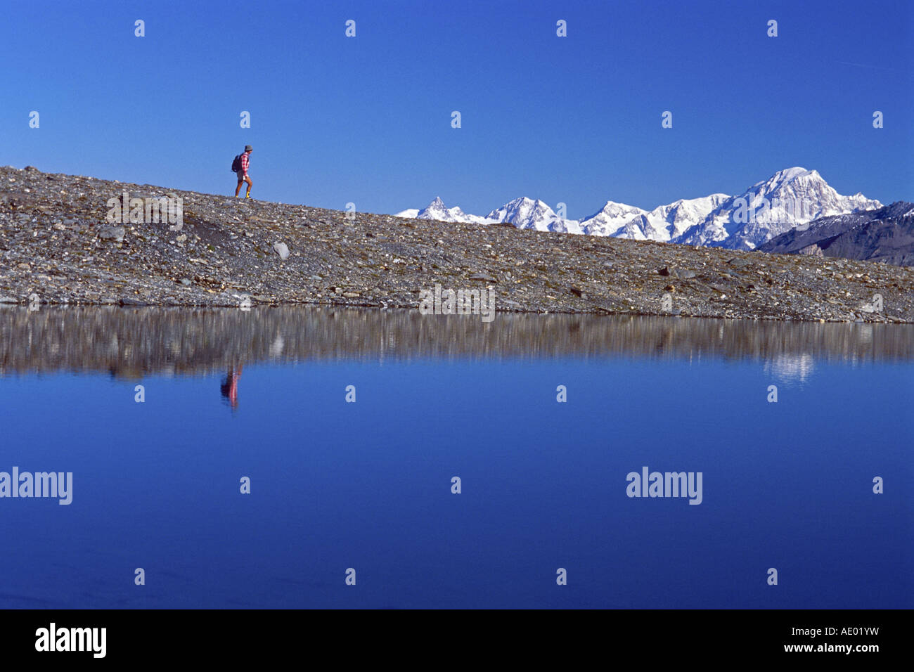 Lake Mean Martin in the National Park of Vanoise, with the Mont Blanc in the background, France, Alps - Stock Image