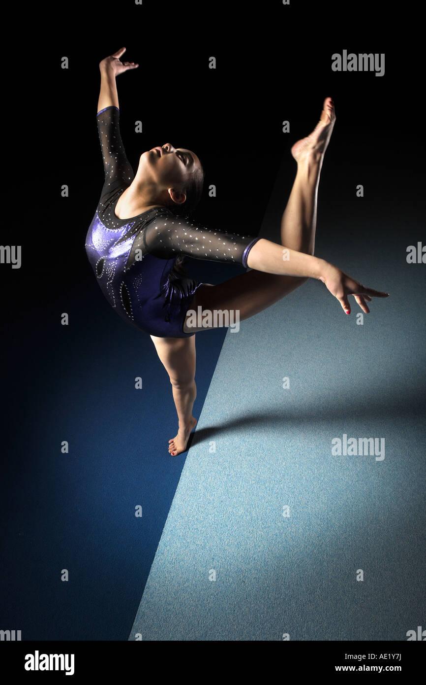 Ballet gymnast gymnastic dancer on floor - Stock Image