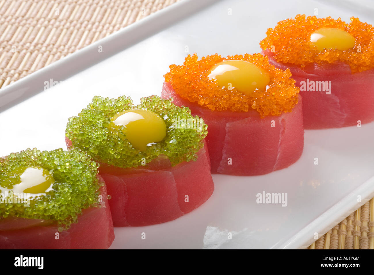 A Japanese dish on a plate consisting of 4 pieces of sushi. Stock Photo