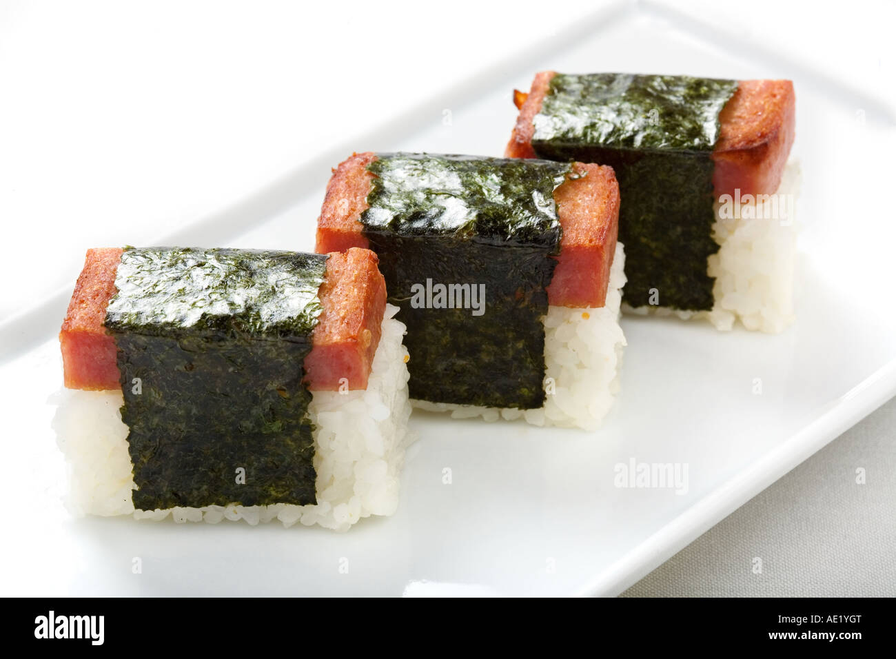 A Japanese dish on a plate consisting of three pieces of rice wraps. Stock Photo