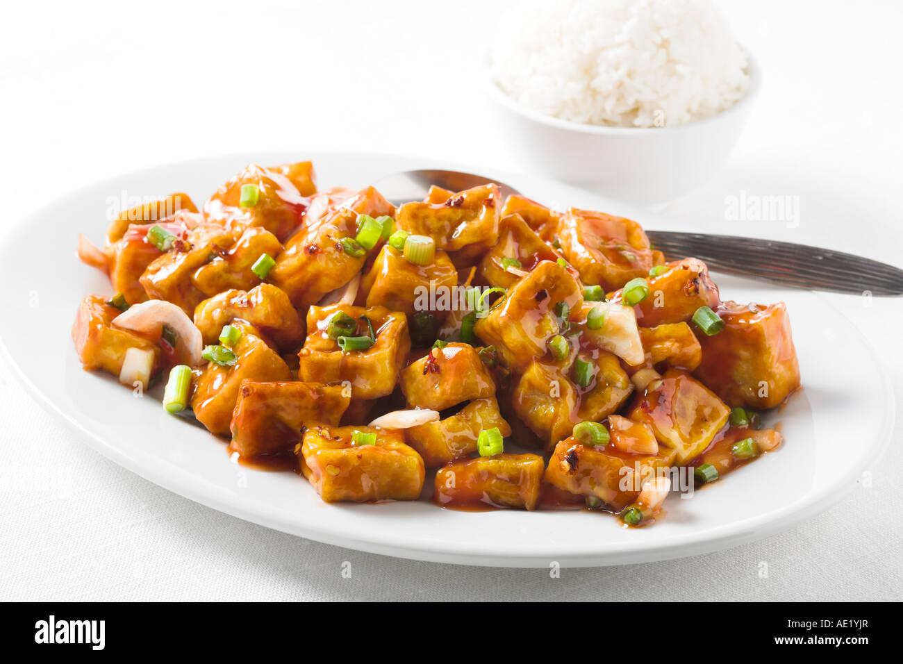 Sezhuan Sze Chuan Crispy Tofu oyster sauce chinese food with green onion dish white plate delicious mouth watering - Stock Image