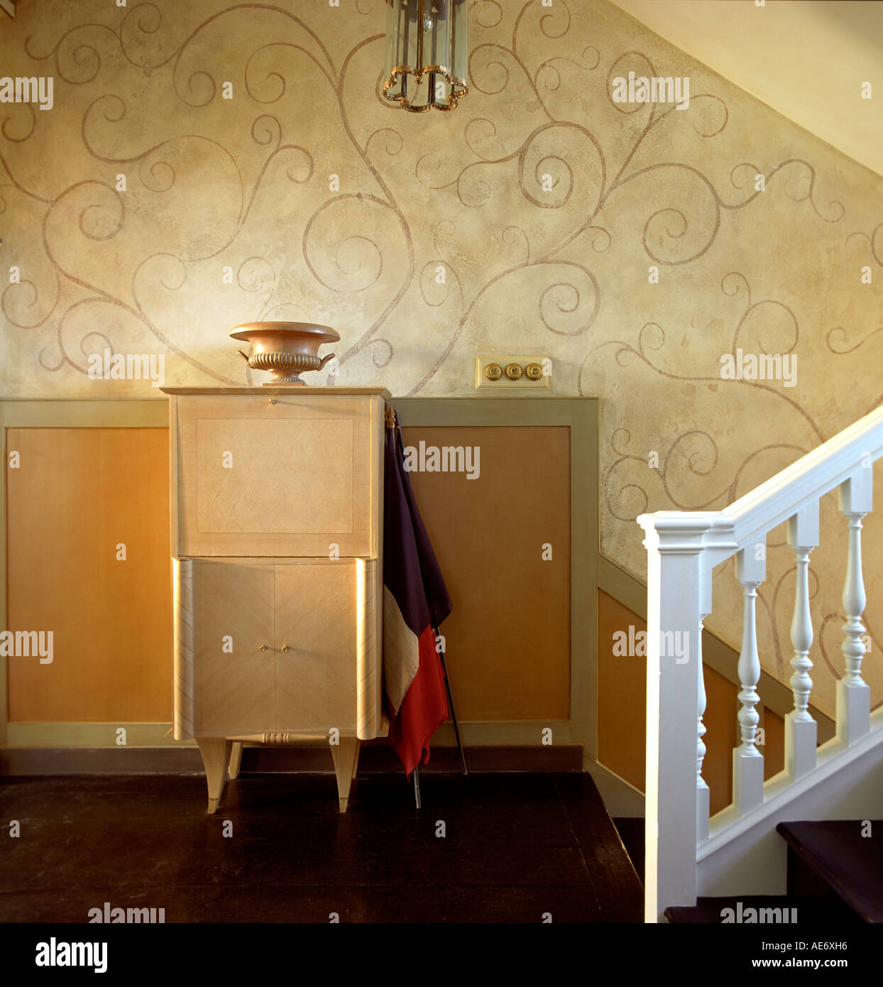 stair landing with cabinet and swirly wallpaper in a georgian stock