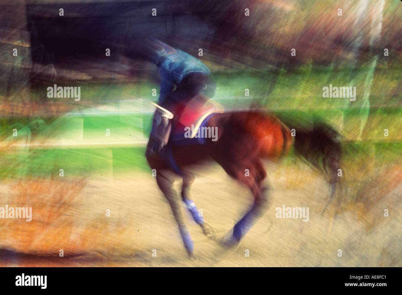 Blurred Motion Image Of A Jockey Riding Galloping Horse At The Race Track