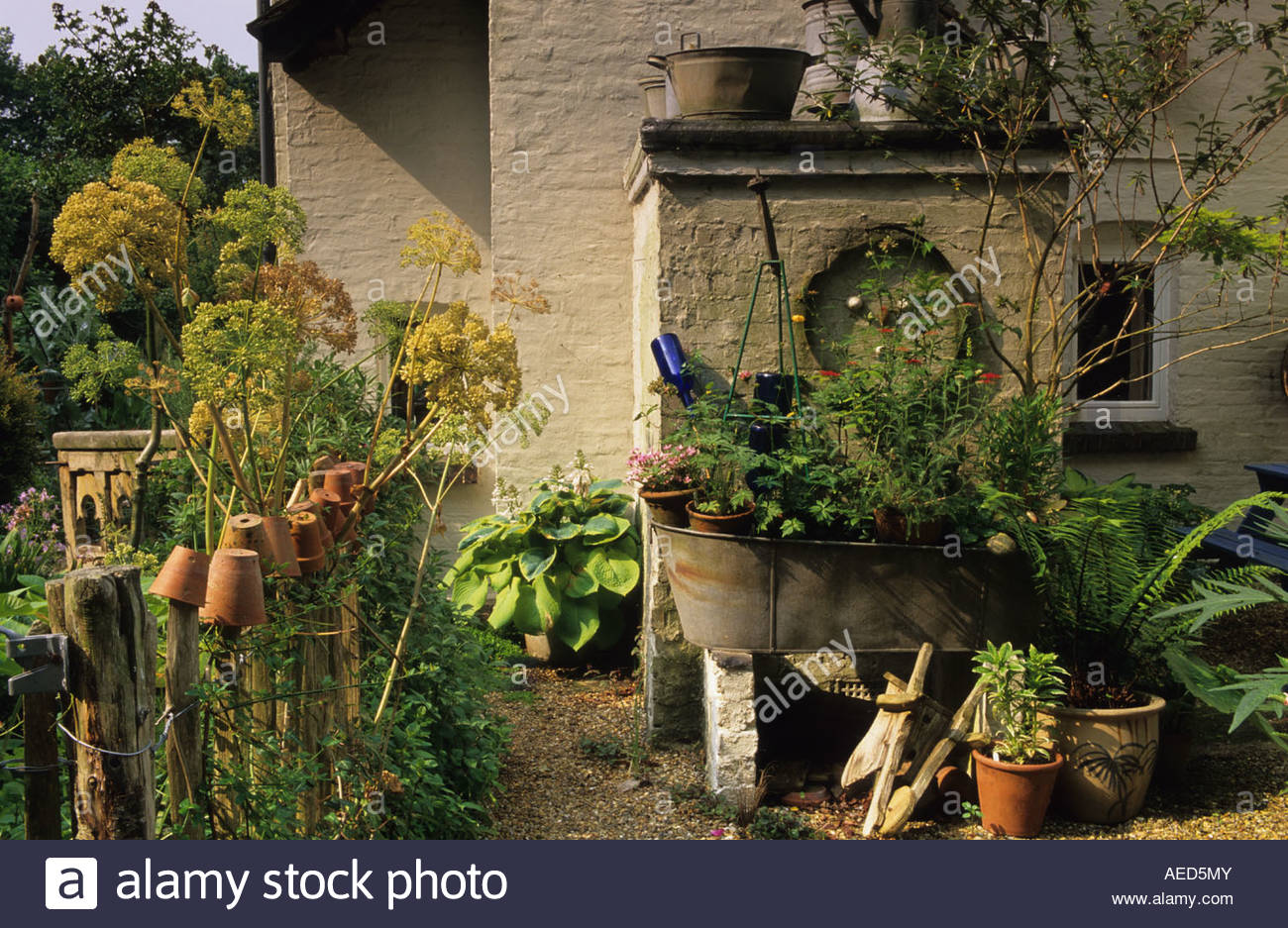 Genial Five Oaks Sussex Rustic Country Garden With Bygones As Sculpture And  Containers Inverted Terracotta Pots On Fence Posts