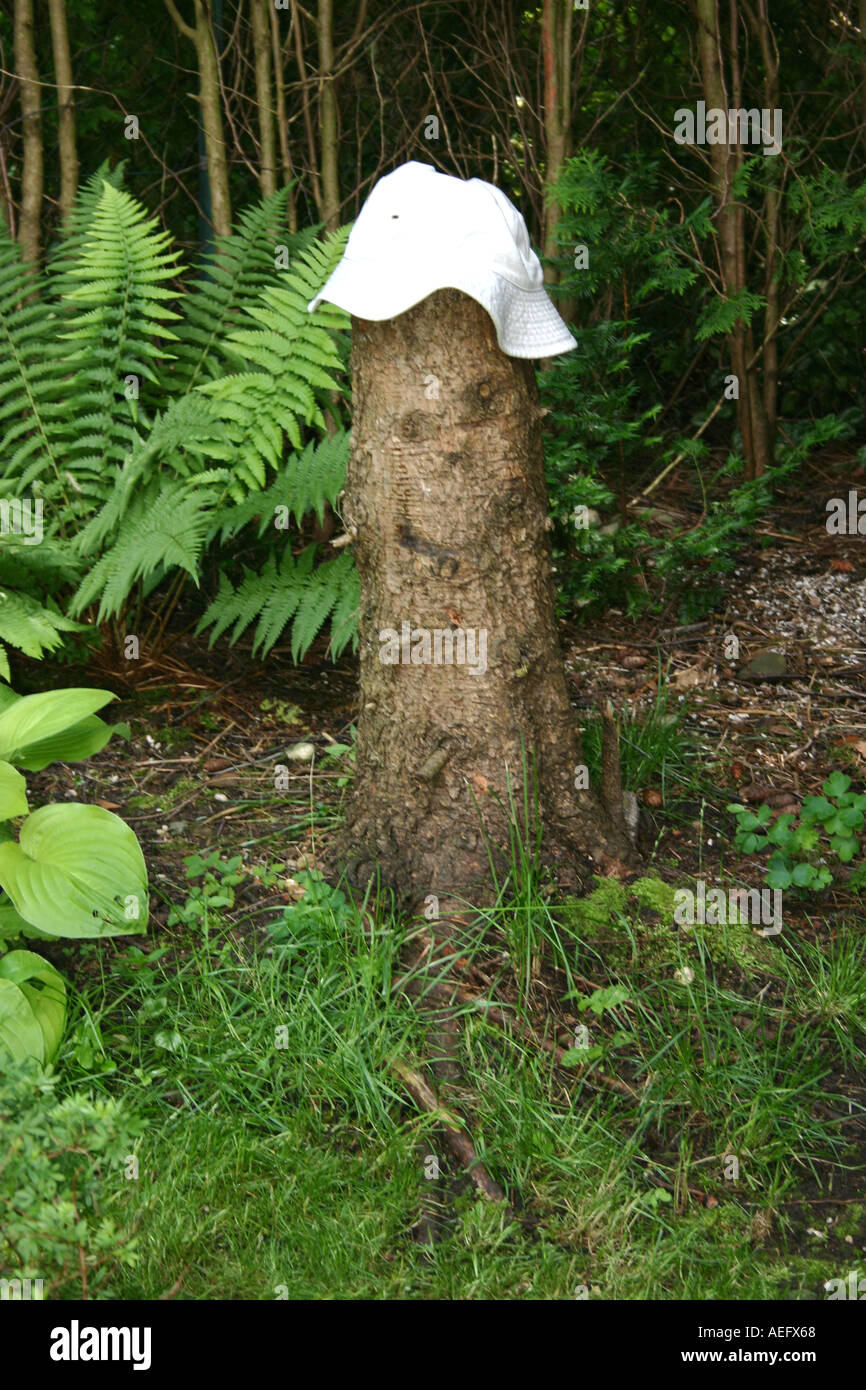 little tree man with a white hat in garden surroundings Stock Photo ...