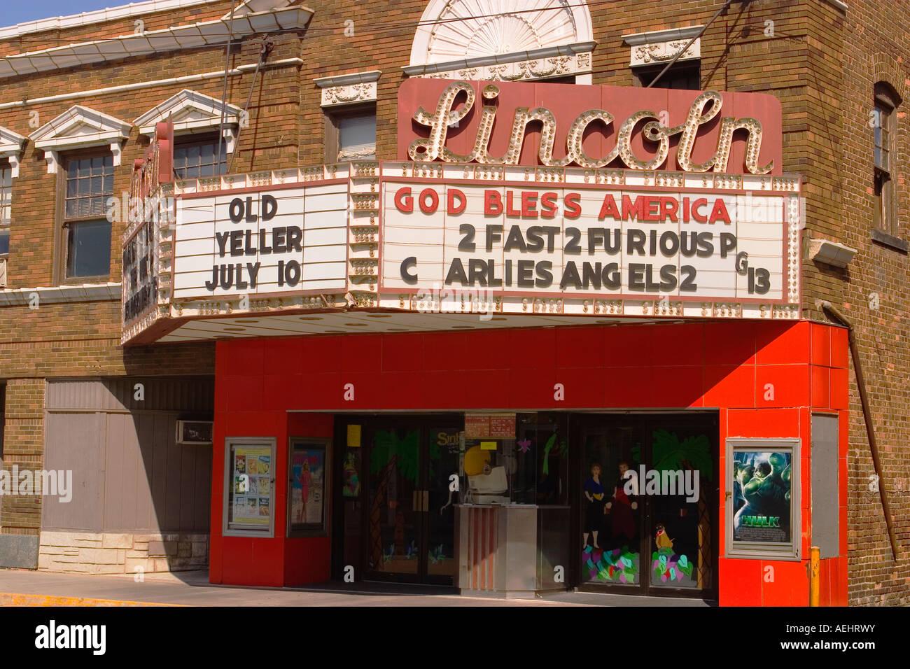 ILLINOIS Lincoln God Bless America and movie titles on cinema marquee in small town square - Stock Image