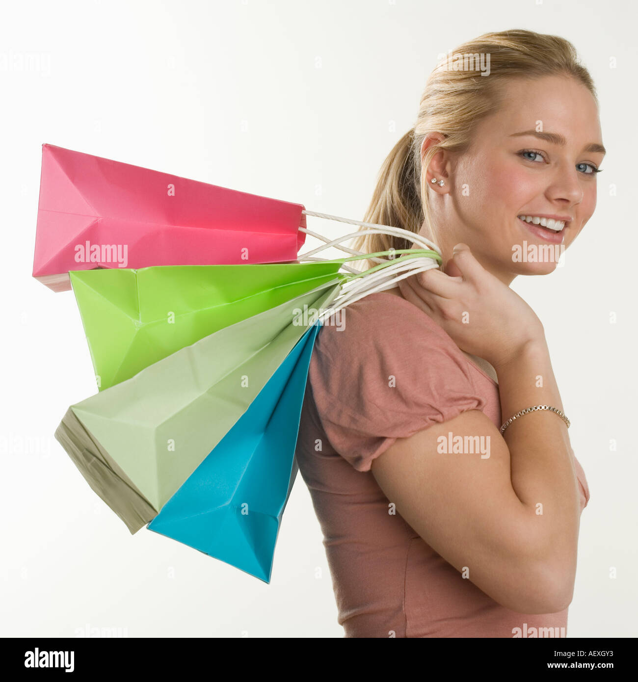 Woman with lots of shopping bags - Stock Image