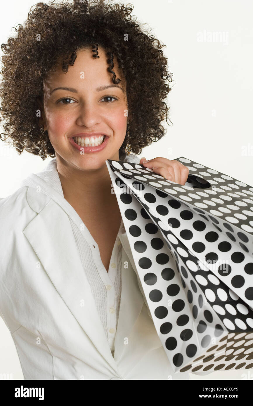 Happy woman with shopping bags - Stock Image