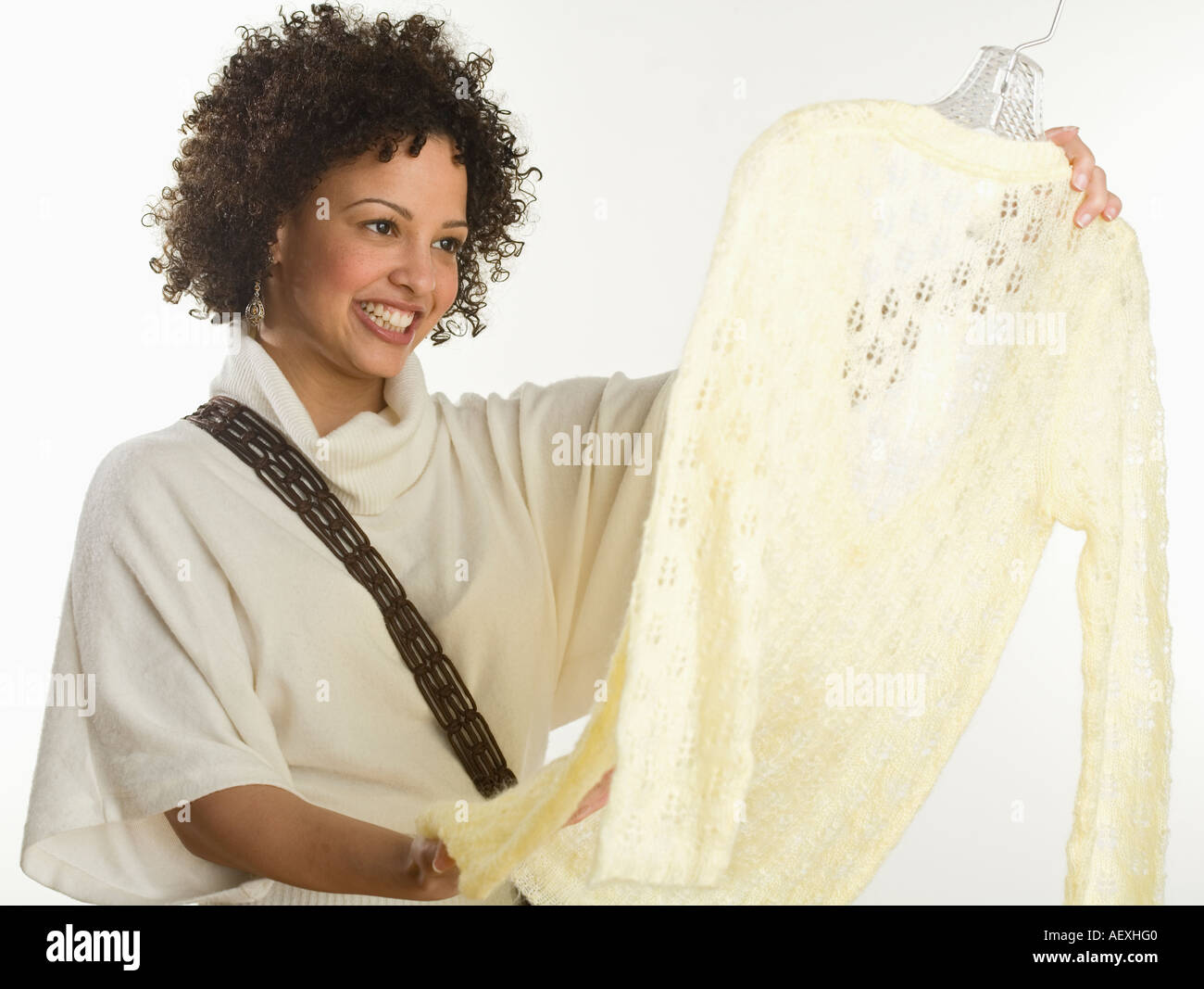 Woman shopping for clothes - Stock Image