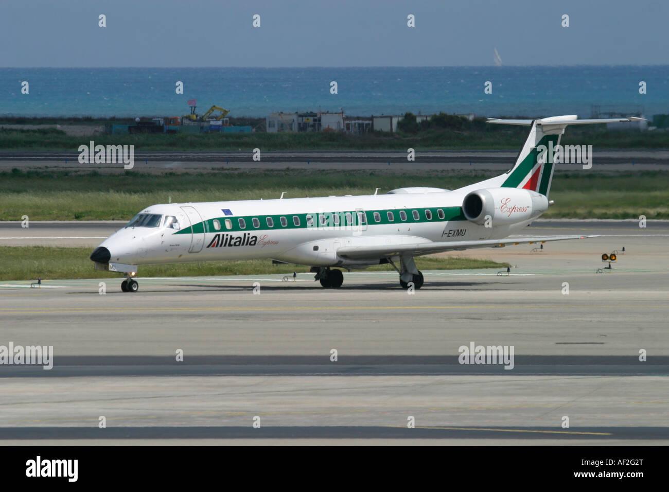 Regional jet Alitalia Express Embraer at Nice Cote d'Azur Airport France - Stock Image