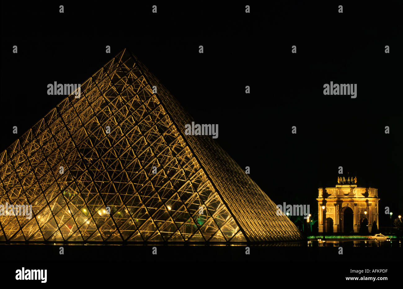 The Louvre Pyramid And The Arc De Triomphe Du Carrousel At Night