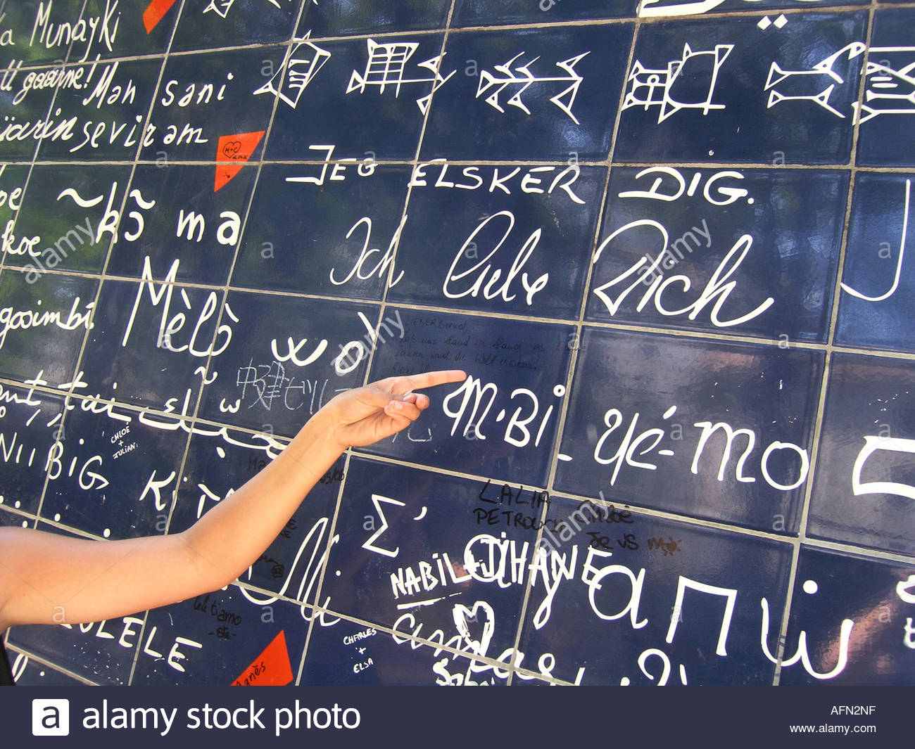 """hand pointing at German text """"Ich liebe dich"""" on Parisian Love wall Place des Abbesses Paris France Stock Photo"""