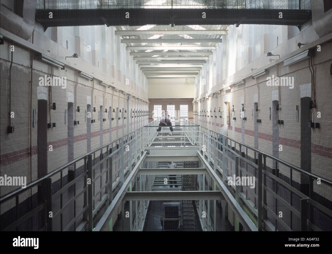 A lone prison officer on a prison wing at Winchester Prison, UK. Stock Photo