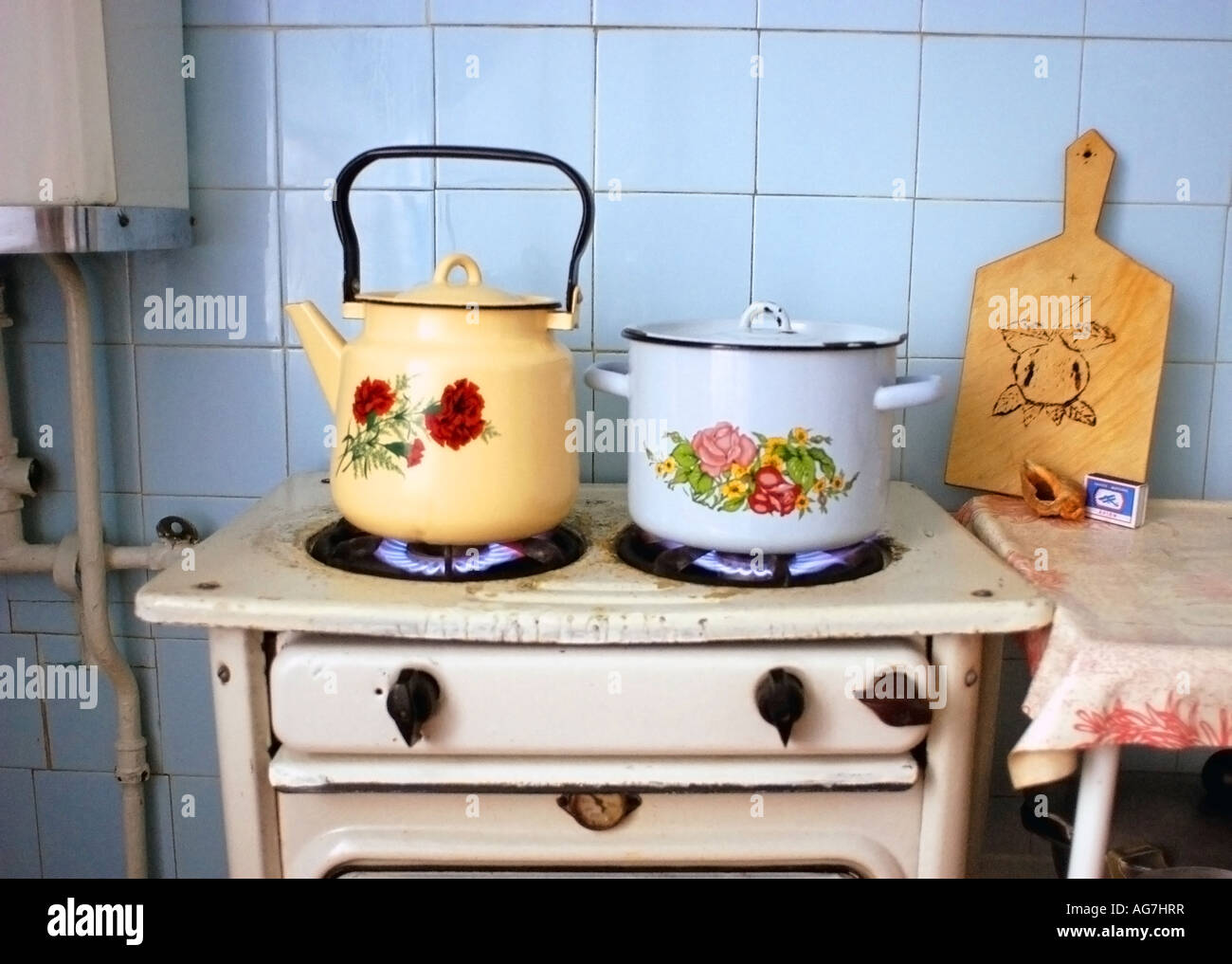 Old style gas cooker with kettle and saucepan shot in a flat in Ryasan Russia. Decorative traditional Russian style & Old style gas cooker with kettle and saucepan shot in a flat in ...