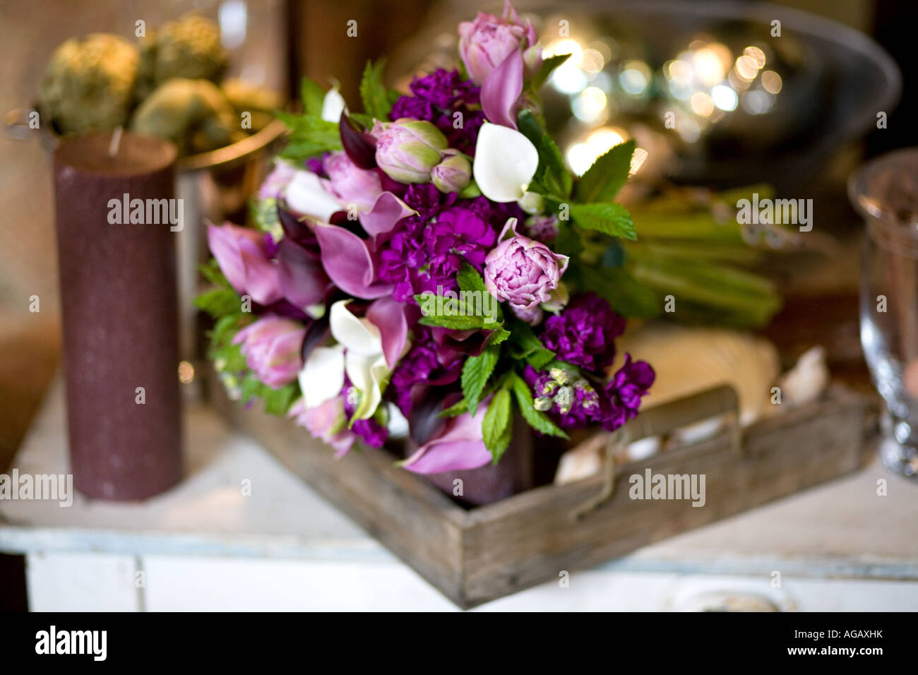 A beautiful purple and white fresh flower hand tied bridal bouquet ...