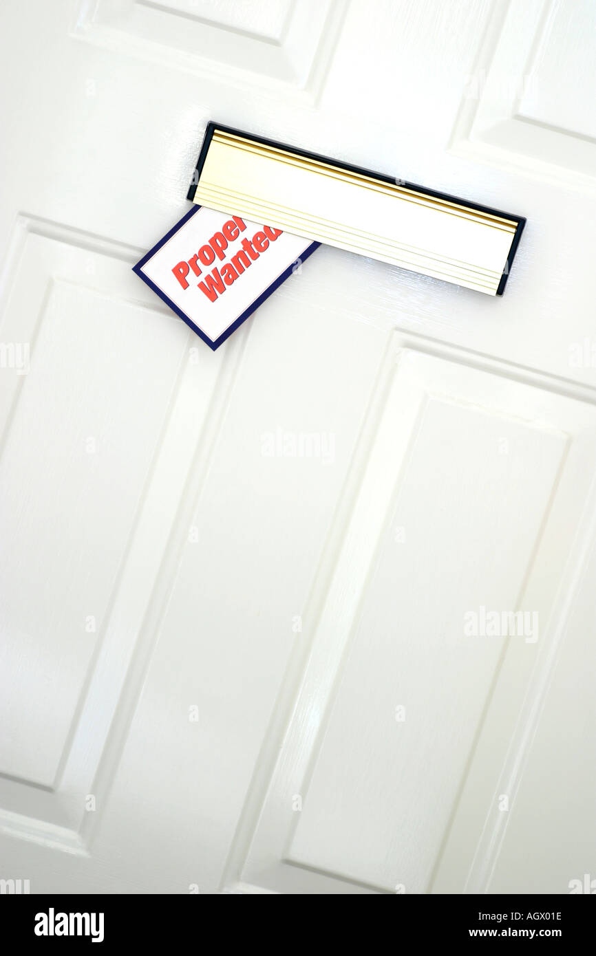 Leaflet in Letterbox - Stock Image