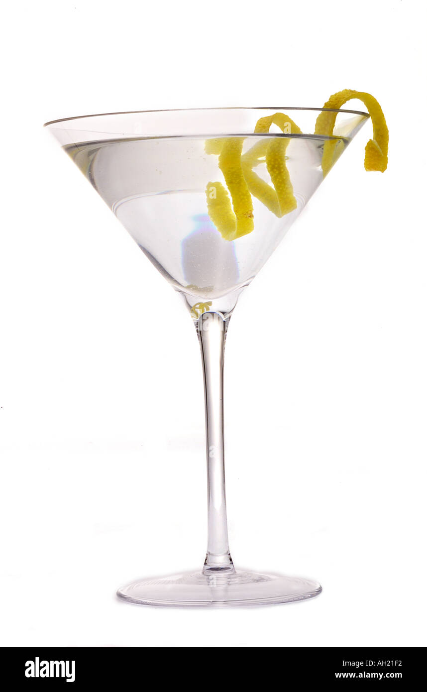 A vodka or gin martini cocktail with lemon twist silhouetted on a vodka or gin martini cocktail with lemon twist silhouetted on white background sisterspd