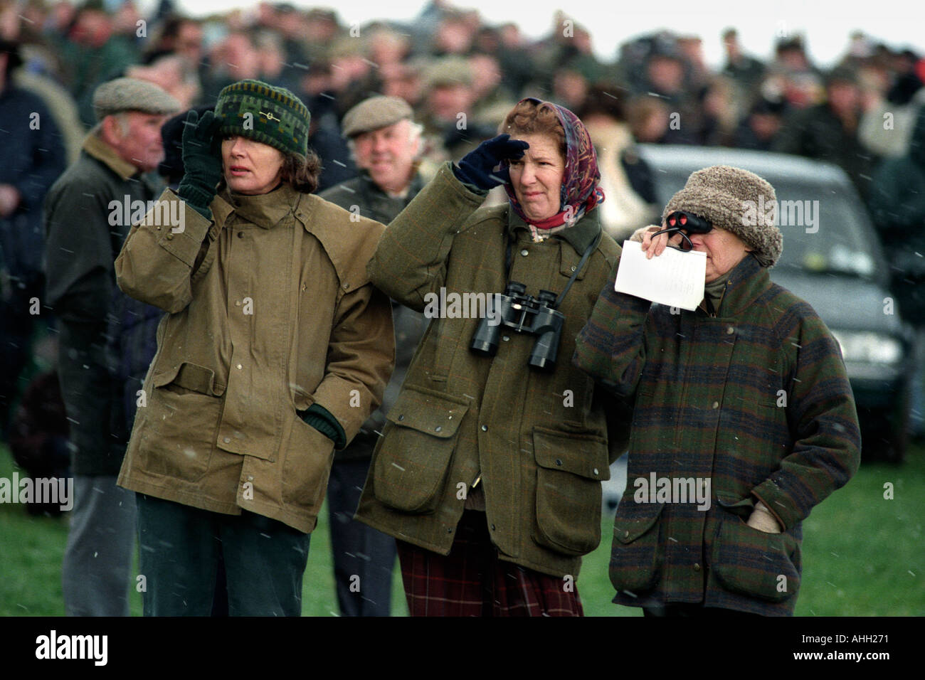 three-ladies-watching-the-horse-racing-in-a-hail-storm-at-the-north-AHH271.jpg