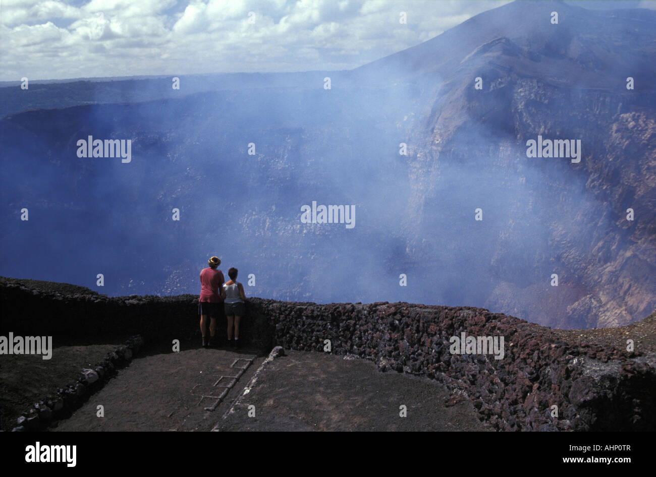 tourists-peering-into-the-active-crater-
