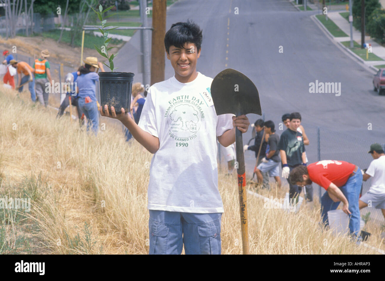 A boy wearing an Earth Day t shirt participating in a tree planting by the Clean Green volunteers of the Los Angeles - Stock Image